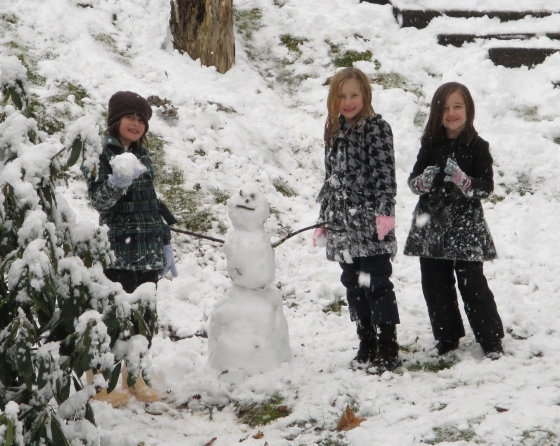 Our oldest granddaughters building their first snowman. <3